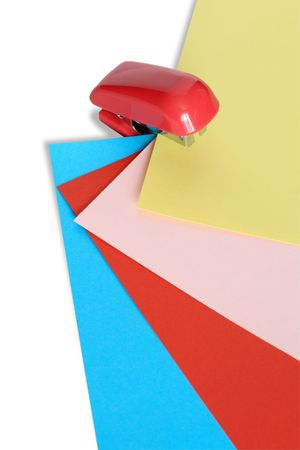 papery: Red stapler with color papery sheets isolated on white background