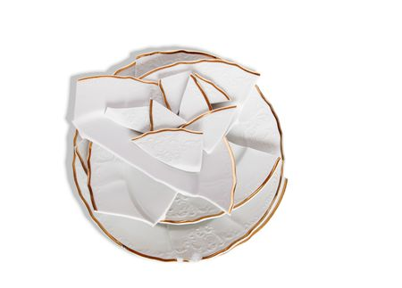 brawl: Few broken plates isolated on white background