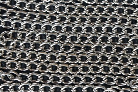 hauberk: Background made from steel chains lying on dark Stock Photo
