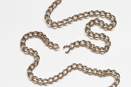 Nice torn chain with shadow lying on white background Stock Photo - 4494080