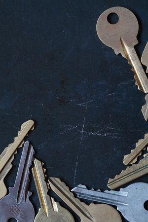 Border made from old keys lying on dark background Stock Photo - 4529812