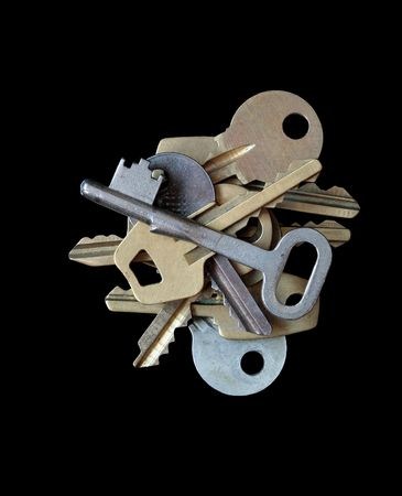 needless: Old keys collection isolated on dark background Stock Photo