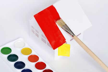 papery: Watercolour set lying near papery house with painting roof and brush Stock Photo