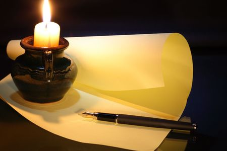 Still-life with candle fountain pen sheet of paper on dark background Stock Photo - 4590238