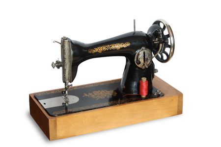 Vintage sewing machine isolated on white background Stock Photo - 4590239