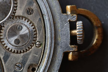Close-up of old watch mechanism as background photo