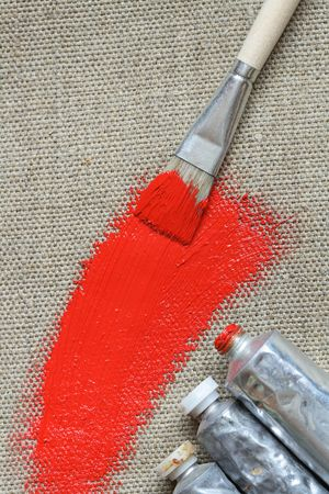 Artist's oil colored with brush and red line on canvas background  Stock Photo - 4665437