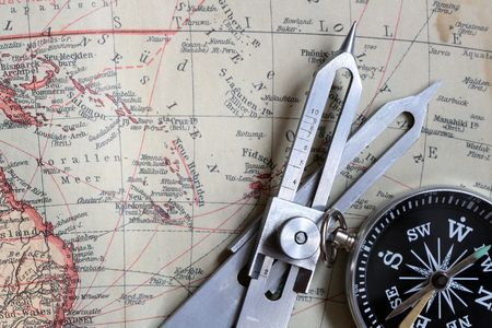 proportional: Proportional Dividers and compass on background with old map Stock Photo