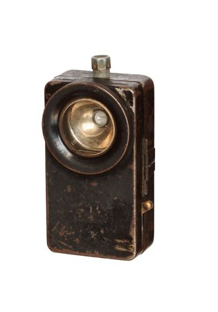 torchlight: Old rusty pocket flashlight isolated on white