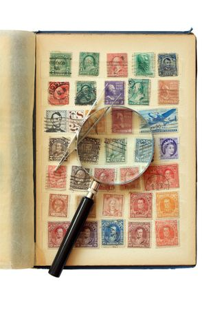 Old stamp album isolated on white background photo
