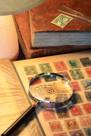 Still life with old stamp album and table lamp photo