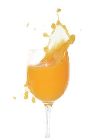 heathy: Goblet with splashing orange juice