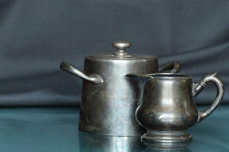 bronze bowl: Antique bronze milk jug and sugar bowl isolated on dark background Stock Photo