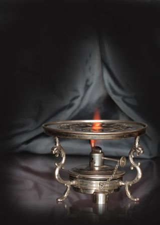 primus: Vintage table spirit stove isolated on dark background with reverberation Stock Photo