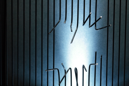 break out of prison: Background made from sawed metal bars with copy space Stock Photo