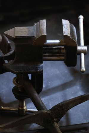 vise grip: Old vice grip on dark background with metal construction