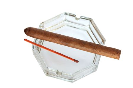 Glass ash-tray with cuban cigar and long wooden match isolated on white with clipping path photo