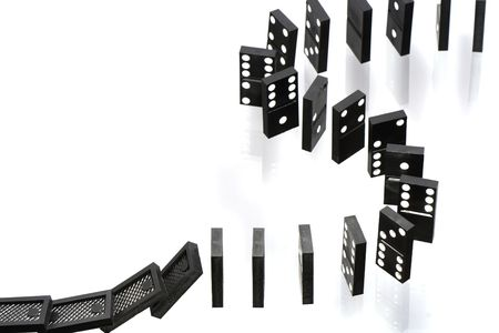 topple: A stack of dominoes falling on white background with copy space Stock Photo