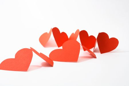 Abstract composition with red paper hearts on white background Stock Photo