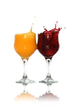 heathy: Two goblets of orange and cherry juice isolated on white background with clipping path