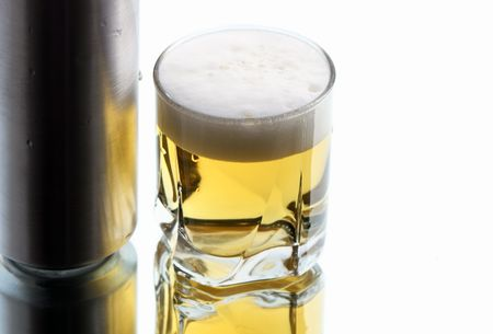 reverberation: Closeup of beer glass and can on white background with reverberation Stock Photo