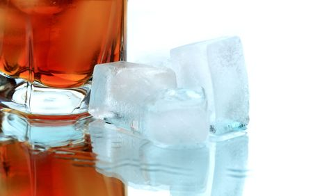 reverberation: Glass of whiskey with ice cubes on white background with reverberation Stock Photo