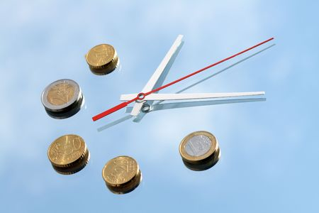 reverberation: Clock hands and few euro coins lying on mirror background with blue sky and clouds reverberation