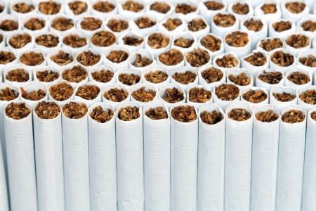 unhygienic: Background made from lot of cigarettes. Extreme closeup
