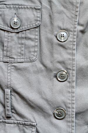 dry cleaned: Extreme closeup della giacca Cachi con pulsanti e una tasca