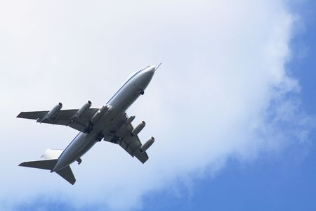 Big passenger airplane on background with blue sky and clouds photo