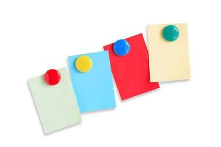 Few colored paper sheets hanging with magnets photo