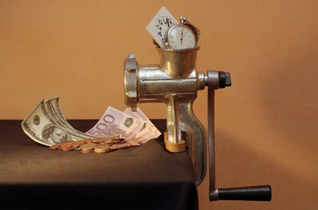 Conceptual still life with mincing machine, money and clock (horizontal image) photo