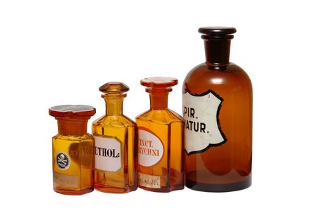 old container: Set of ancient glass empty pharmaceutical phials isolated on white