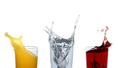 multy: Three glasses with various motley splashing beverages Stock Photo