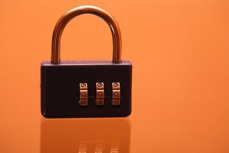 Modern blue combination padlock standing on ginger background Stock Photo - 7883381