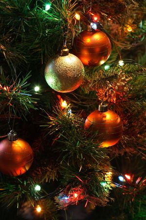 Background closeup of glass colored balls hanging on Christmas tree