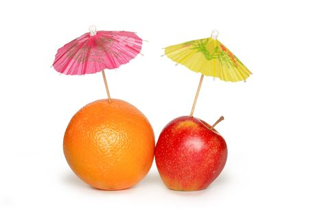 sunshades: Orange and apple with small paper sunshades on white background. Clipping path included Stock Photo