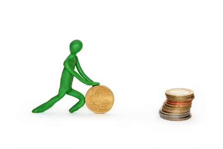 sisyphus: Green plasticine man rolling coin to stack of coins. Isolated on white