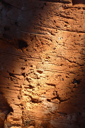 Extreme closeup of brick wall with a ray of light photo