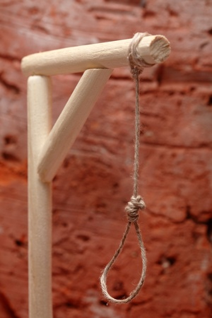 capital punishment: Gibbet with loop on red brick wall background