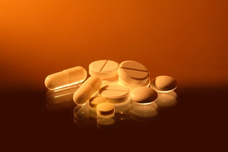 reverberation: Closeup of various pills with reverberation on sradient background