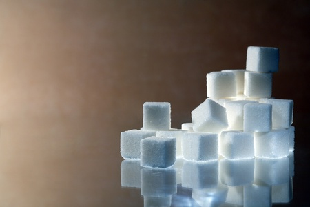 reverberation: Stack of sugar cubes with reverberation on nice gray background with copy space Stock Photo