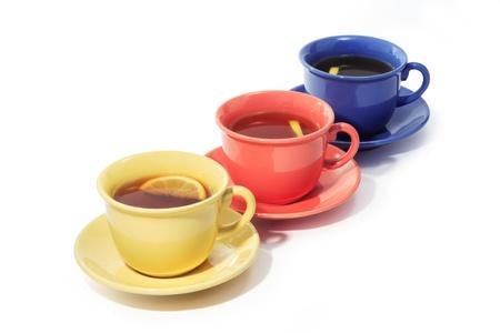 multy: Three color cups of black tea with lemon