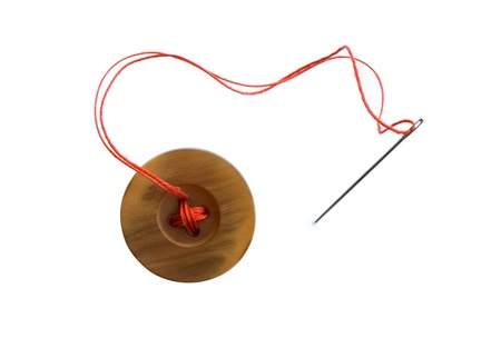 Closeup of button and needle with read thread on white background Stock Photo