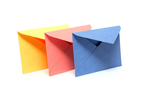 Colorful envelopes standing in a row on white background photo