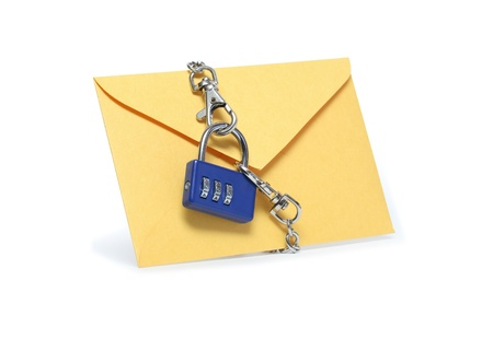 Yellow paper envelope attached with padlock and chains. Isolated on white with clipping path Stock Photo - 9222184