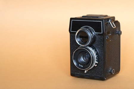 Vintage twin lens camera on nice yellow background photo