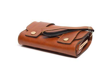 change purse: Modern brown leather change purse lying on white background
