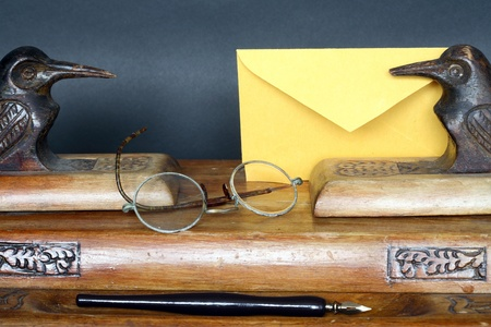 Nice old vintage wooden desk set and envelope on dark background Stock Photo - 9451264