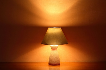 luminous: Nice luminous desk lamp on ginger background with copy space